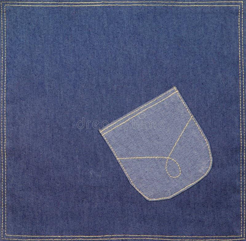 Casella su un tessuto del denim immagine stock