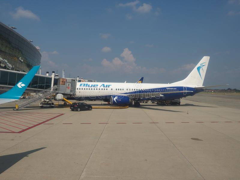 Blue Air Boeing 737-800 boarding in Caselle. CASELLE, ITALY - CIRCA AUGUST 2019: Blue Air Boeing 737-800 during boarding stock photos