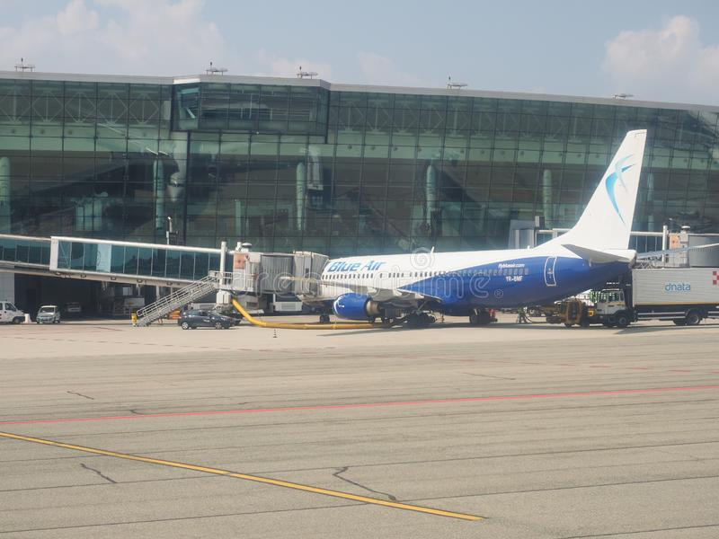 Blue Air Boeing 737-800 boarding in Caselle. CASELLE, ITALY - CIRCA AUGUST 2019: Blue Air Boeing 737-800 during boarding stock photography