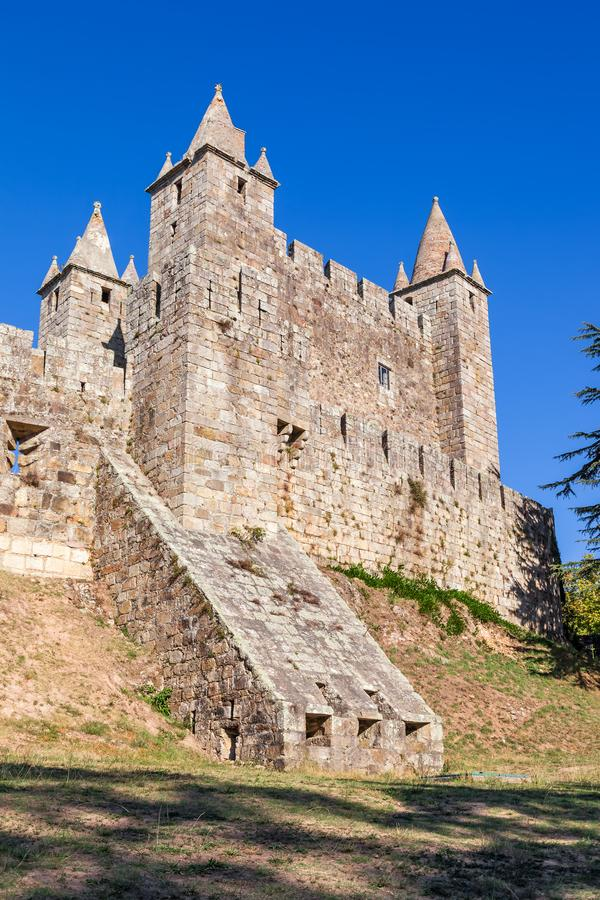 Casemate bunker emerging from the walls and the keep of Castelo da Feira Castle. Santa Maria da Feira, Portugal stock images