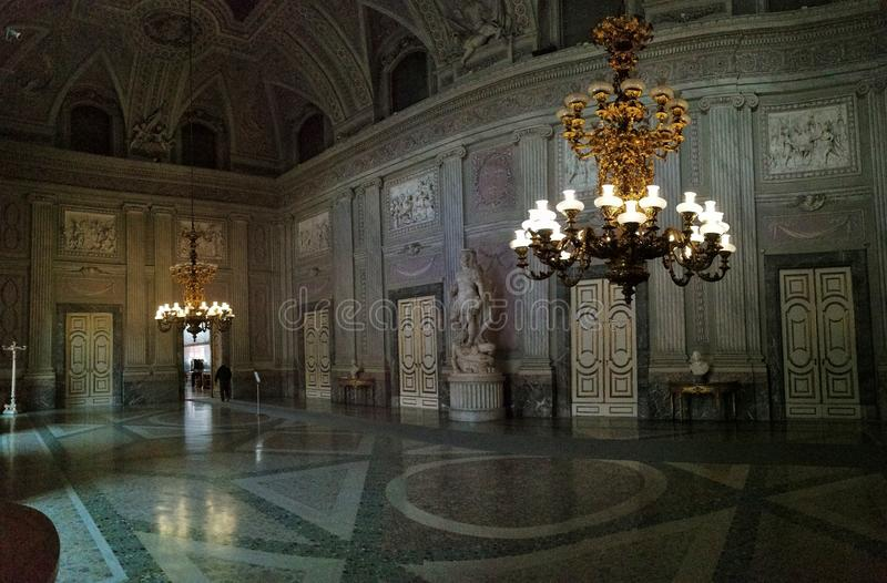 Royal Palace of Caserta - Hall of the Guards. Caserta, Campania, Italy - February 3, 2019: Royal Palace of Caserta - Panoramic picture of the Hall of the Royal royalty free stock images