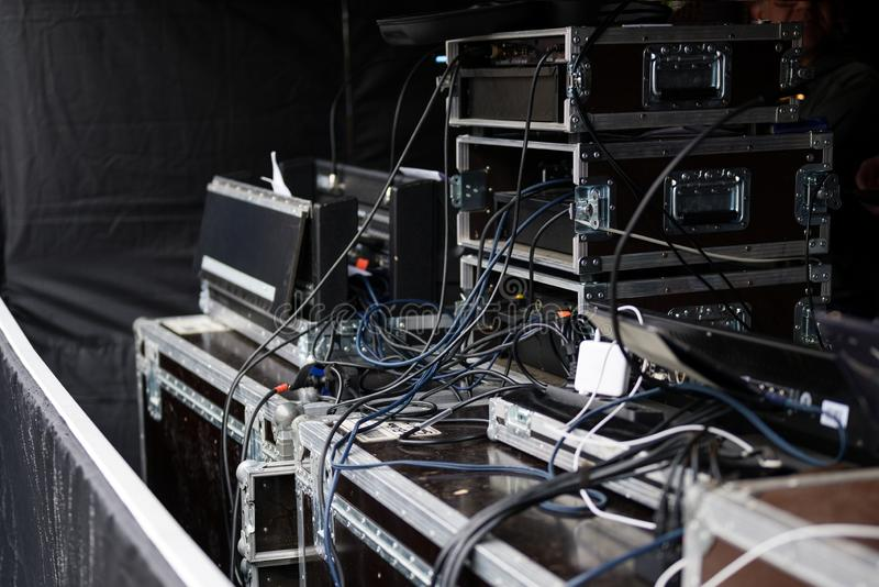 Cases and racks from a sound amplification system for an event on an open-air stage royalty free stock photography