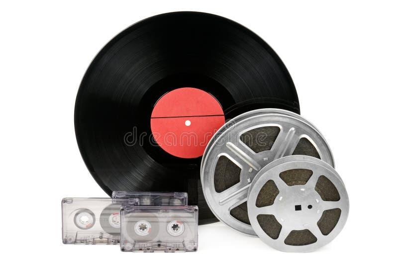 Casetes audios, expedientes y tira de la película imagen de archivo libre de regalías