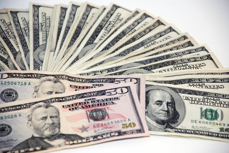Cash. A stack of cash layed out stock photos