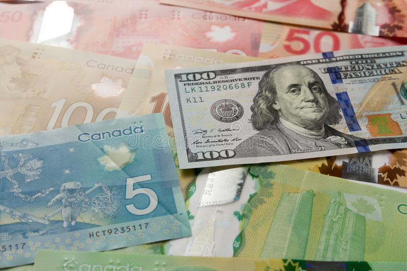 Cash bills from Canada and USA currency. Full frame of bills spread on table and assorted amounts. Cash bills from Canada and USA currency. Canadian Dollars and royalty free stock photography