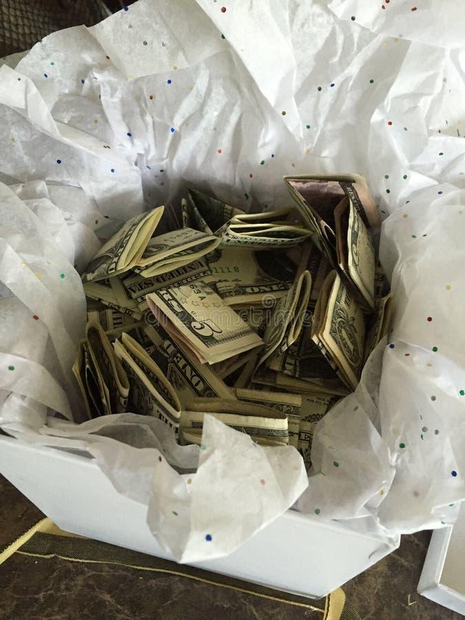 Cash in a box stock photos