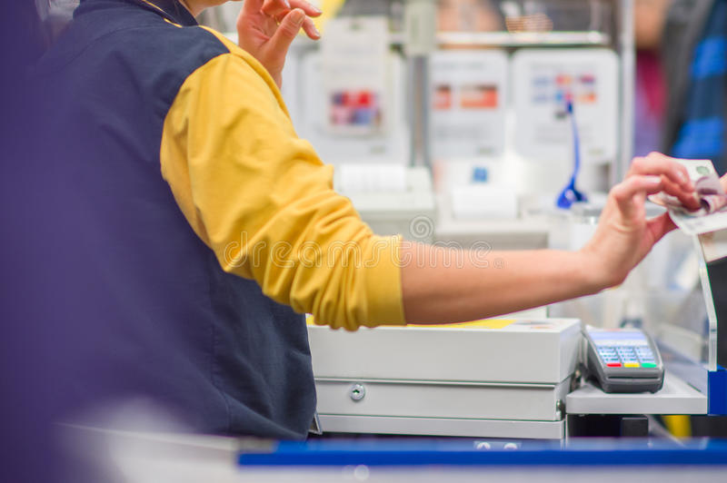 Cash-desk with cashier and terminal in shop stock images