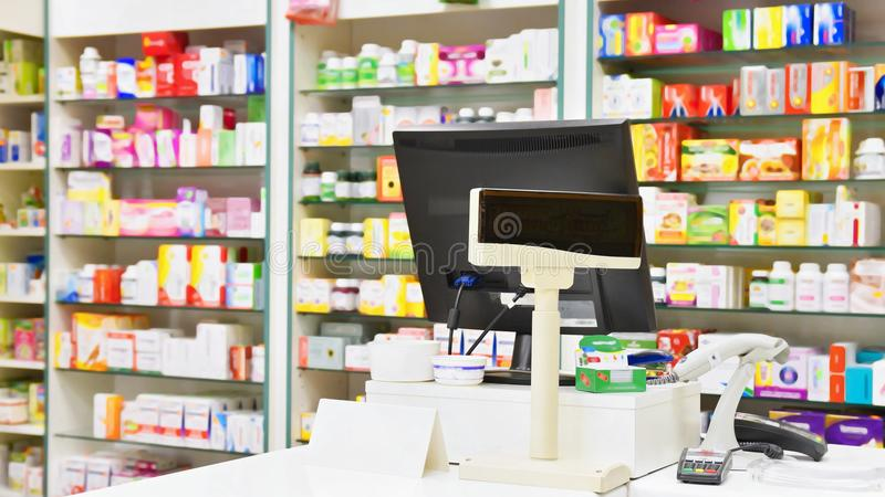 Cash desk - computer and monitor in a pharmacy. Interior of drug and vitamins shop. Medicines and vitamins for health and healthy. Lifestyle royalty free stock image