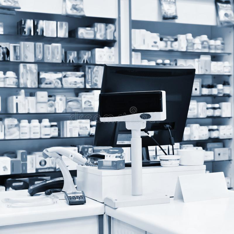Cash desk - computer and monitor in a pharmacy. Interior of drug and vitamins shop. Medicines and vitamins for health and healthy. Lifestyle royalty free stock photo