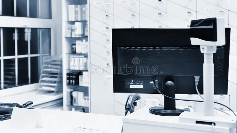 Cash desk - computer and monitor in a pharmacy. Interior of drug and vitamins shop. Medicines and vitamins for health and healthy. Lifestyle stock images