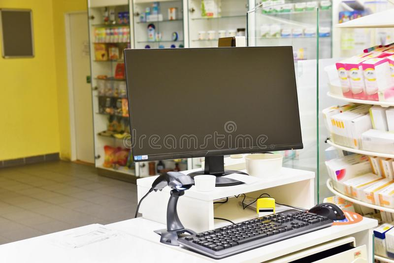 Cash desk - computer and monitor in a pharmacy. Interior of drug and vitamins shop. Medicines and vitamins for health and healthy. Lifestyle stock photo