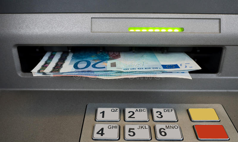 Cash dispenser with Euros royalty free stock photography