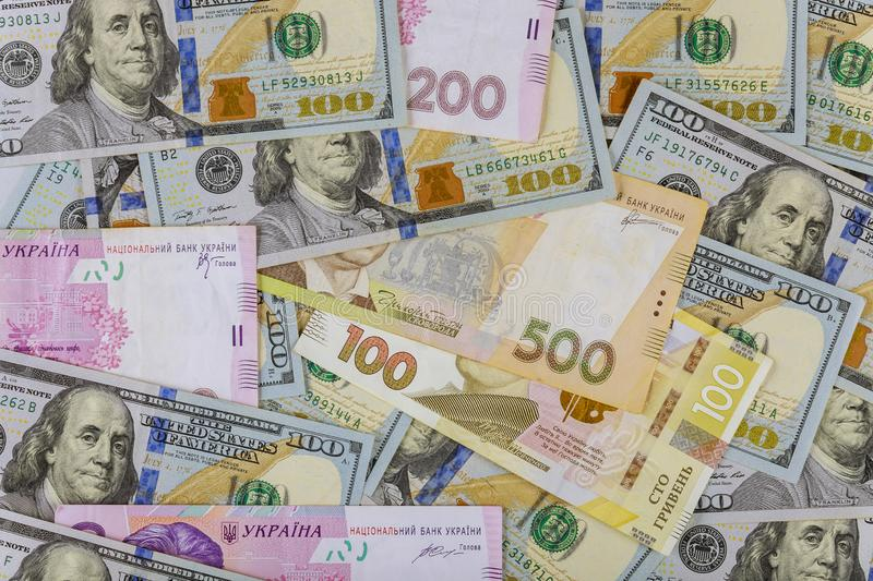 Cash money finance investment American dollars banknotes and Ukrainian Money royalty free stock images