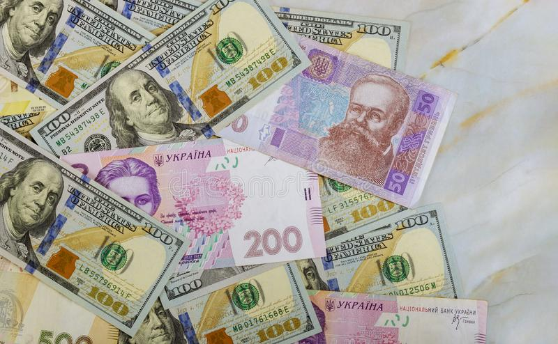Cash money finance investment American dollars banknotes and Ukrainian Money royalty free stock image