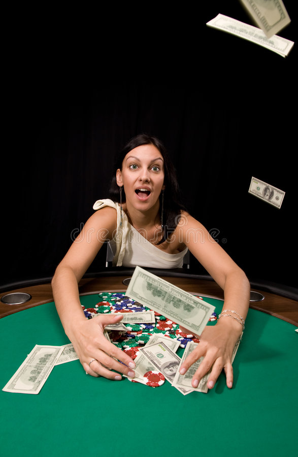 Cash flow. Dollar bills flows from sky in casino over black stock photo