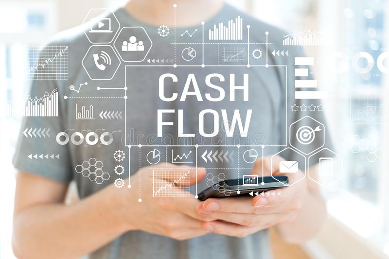 Cash flow with man using a smartphone. Cash flow with young man using a smartphone stock photo