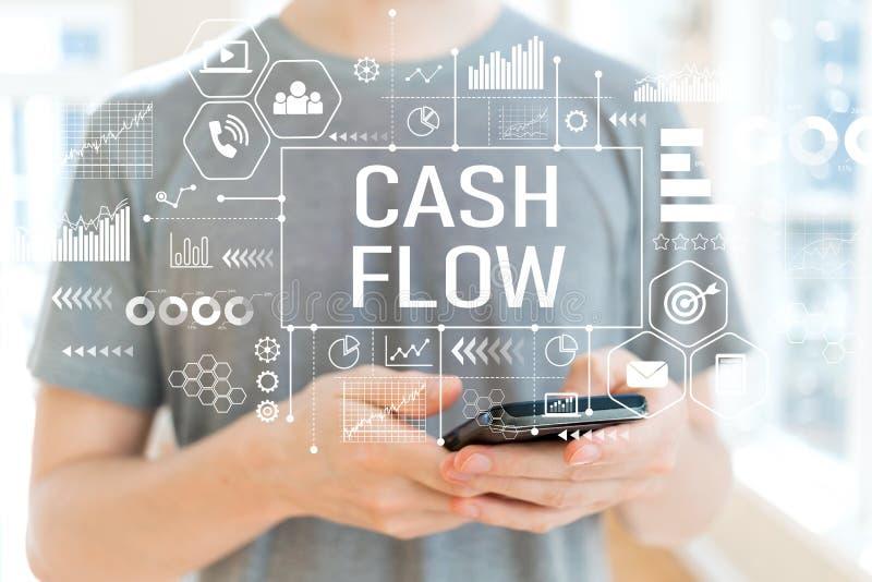 Cash flow met de mens die een smartphone gebruiken stock foto