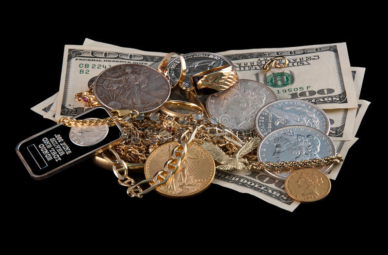 Scrap Gold and Silver for Pawn. Scrap gold, silver and jewels with cash on black background stock images