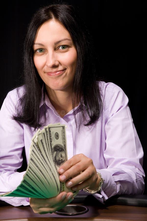 Cash in hands. Pretty caucasian girl holds cash in hands in casino stock photo