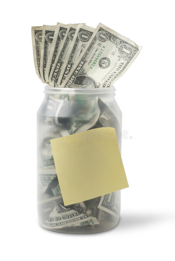 Cash jar with dollar bills and sticky note. Cash jar overflowing with US Dollar Bills and a yellow sticky note. Studio shot isolated on white background, saved stock images