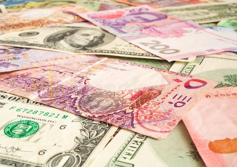 Cash money from various countries (Dollar, Qatari riyal, hryvnia). Exchange business concept background. Background from paper money of the different countries ( stock photo