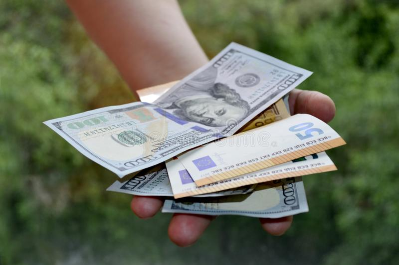Cash notes in hand stock images