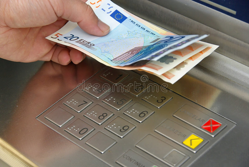 Cash point. Human hand and the cash machine royalty free stock photos