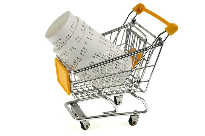 Cash receipt rolled in a supermarket cart. Supermarket cart close up on white background with a receipt in stock illustration