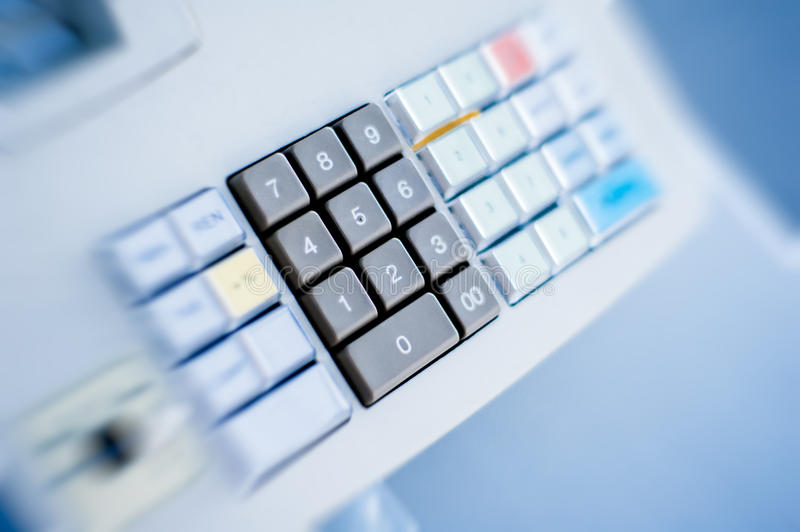 Cash register buttons detailed. Cash register buttons on blue background royalty free stock photo