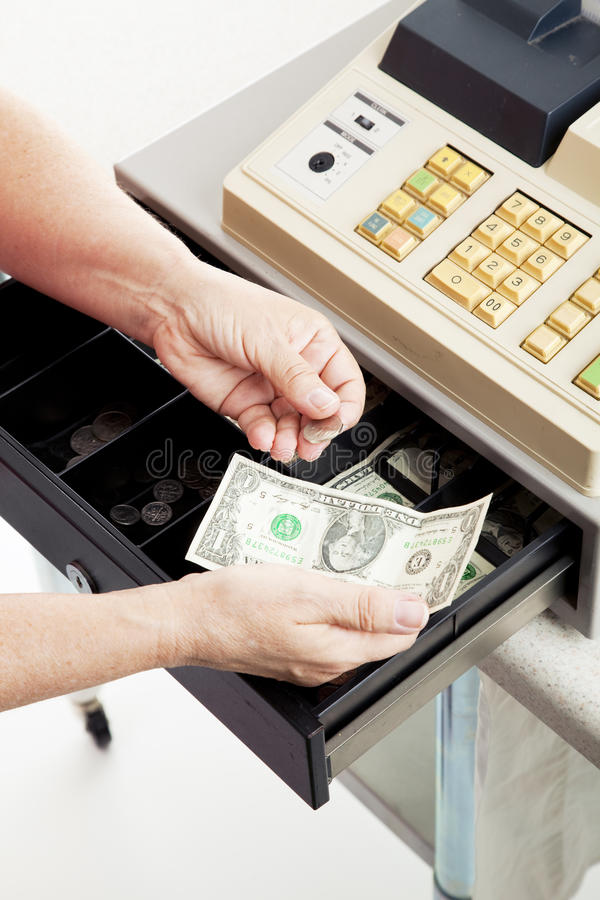 Cash Register - Small Change. Closeup of a cashier's hands making change from a cash register royalty free stock photo