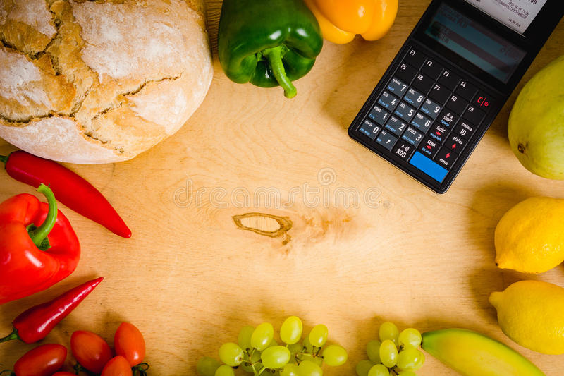 Cash register and vegetables on the table stock image