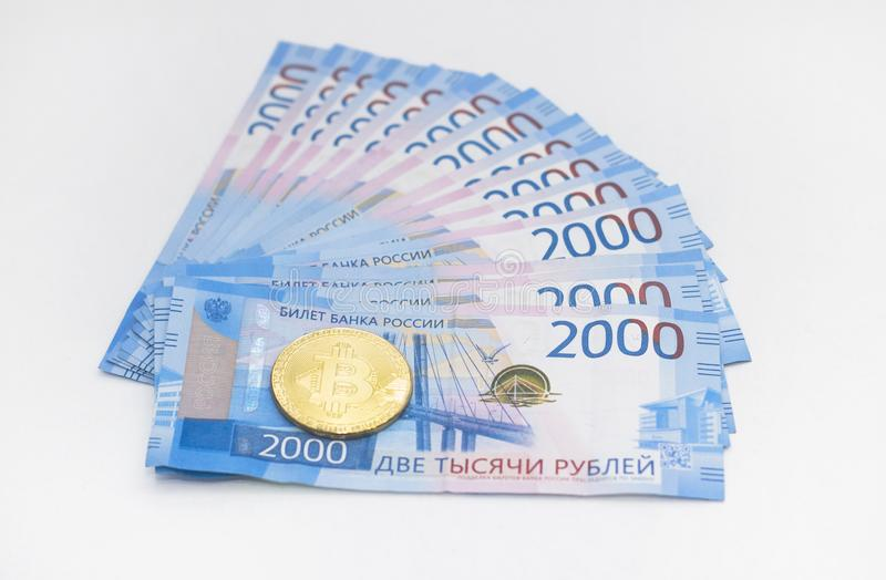Cash rubles and electronic currency bitcoin. on white background stock images