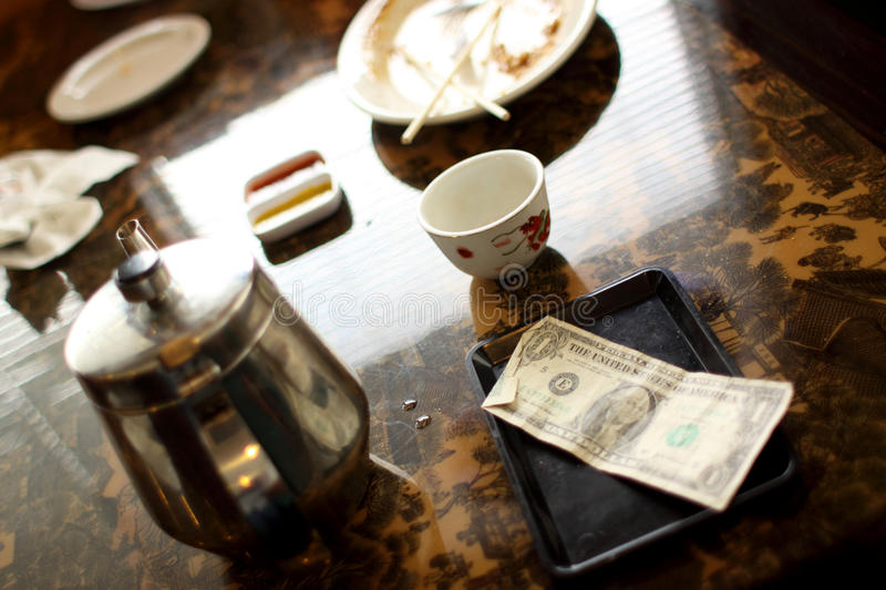 Cash tip on table royalty free stock photos