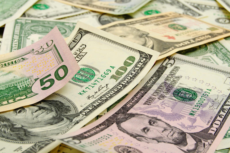 Cash US dollars. Banknotes dollars in disorder lie in the plane stock photos