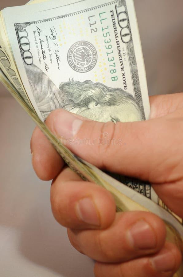 Cash. Wad of $100 dollar bills stock photos