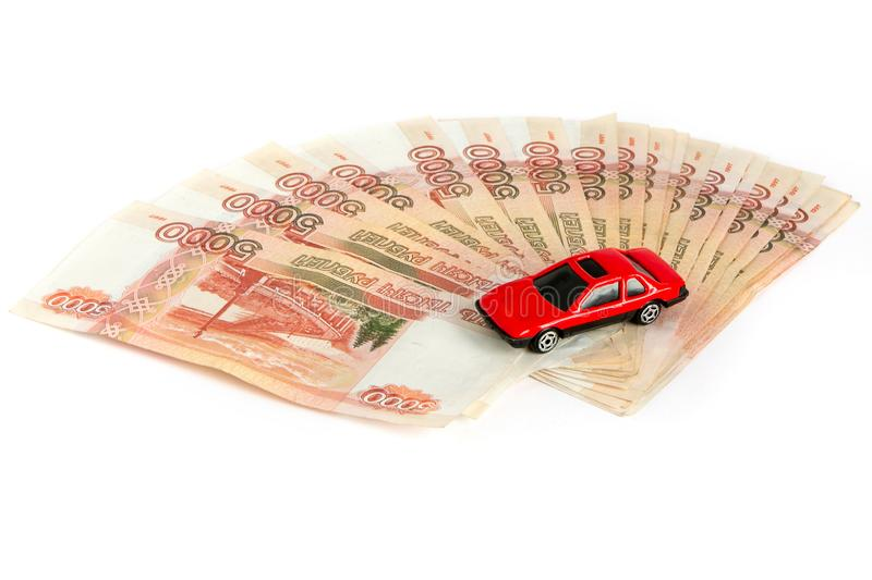 Cash on white background. Toy car on the money. Bills 5 thousand rubles, spread out like a fan stock photos