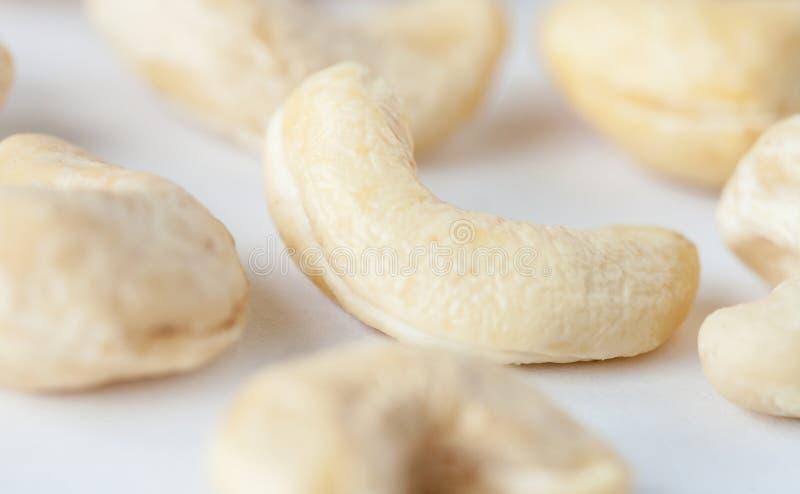 Cashew. Many cashew on neutral background- macro shot stock image