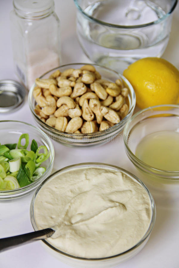 Cashew mayo ingredients vertical stock photo