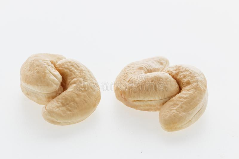 Cashew nuts heap peeled on a white background stock images