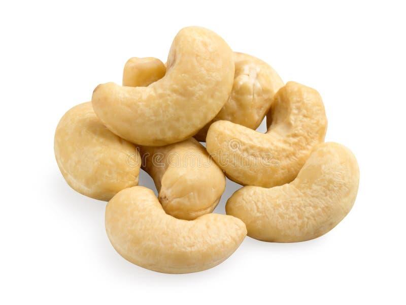 Cashew nuts heap on white background closeup stock photos