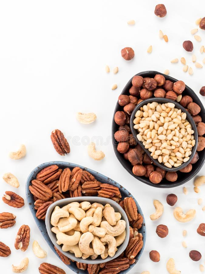 Cashew, pecan, pine nuts, hazelnut isolated stock photography
