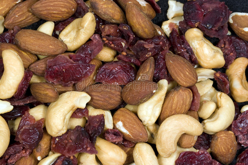 Cashews, Almonds, and dried Cranberries. Close up of cashews, almonds, and dried cranberries stock photos