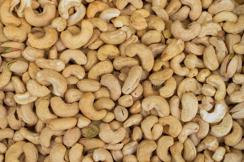 Cashews rich in heart friendly fatty acids. Healthy food. Cashew nuts as food background. Top view. Close-up royalty free stock photo