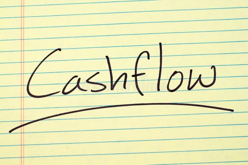 Cashflow på ett gult lagligt block stock illustrationer
