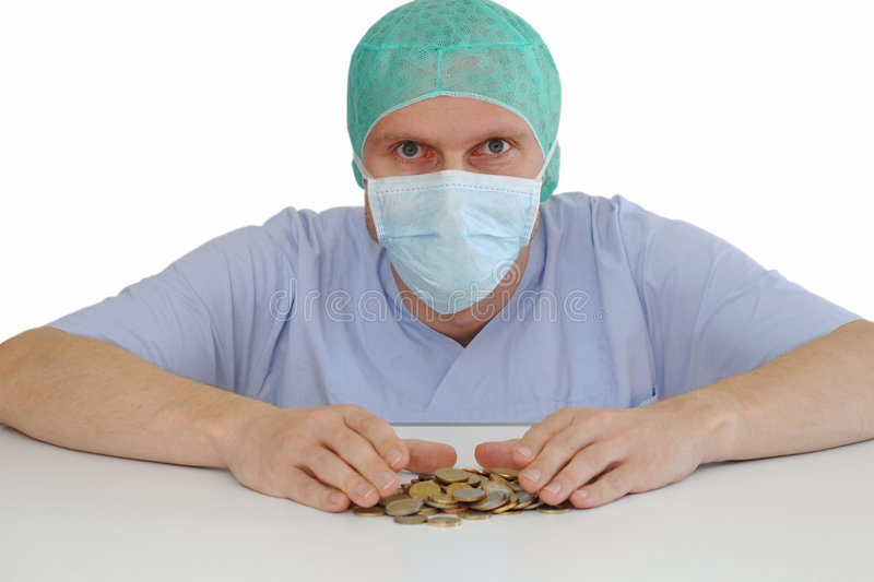 Cashhungry surgeon. Germany focus on eyes royalty free stock images