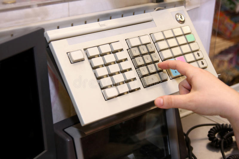 Cashier. Typing to the cashier at the supermarket royalty free stock photography