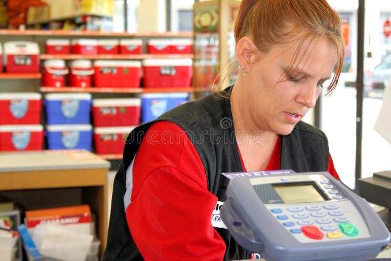 Cashier. Photo taken of a cashier checking out a customer royalty free stock photos