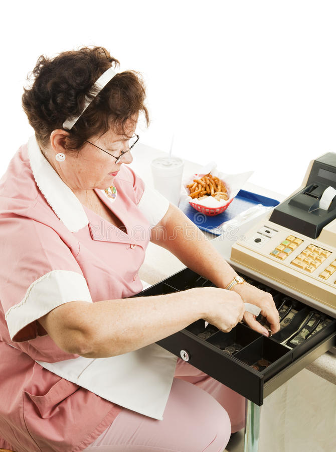 Cashier in Cafeteria. Makes change with fast food lunch on the counter royalty free stock photography