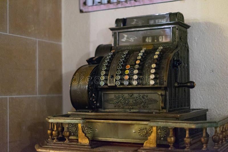 A cashier calculator vintage machine. A cashier calculator vintage machine in the cafe stock photography