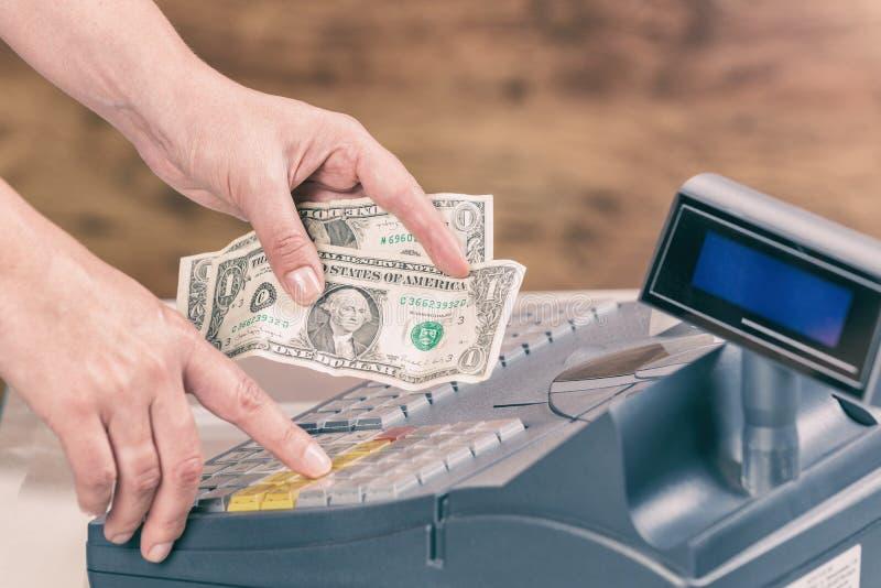 Cashier holdnig banknotes stock photo
